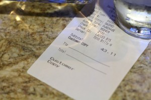 A receipt on a restaruant table.