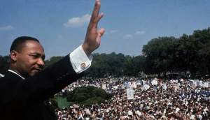 Dr. Martin Luther King Jr. waves to the crowd at the National Mall in Washington, DC, August 28, 1963. Photo by Francis Miller.