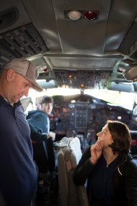 Instructor Dan Madden shows student Teresa Olguin how to start the APU system of the Boeing 727 at McClellan Park Airfield.